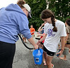 Jackie Nicholson of Gardner gets her bucket filled prior to the Gardner City Wide Ice Bucket Challenge for ALS which netted about $2200 SENTINEL&ENTERPRISE/ Jim Marabello