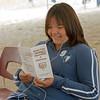 Juanita Chakasim reading Moose Cree pamphlet