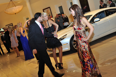 "Photograph at Gaudin Luxury Cars Party in Las Vegas with DSM Luxury. ""Follow The Fun With DSM"" Photograph by Las Vegas photographer Mark Bowers."