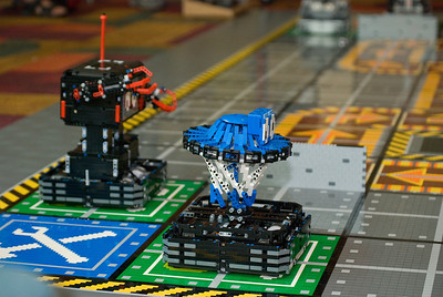 Sweet remote controlled Lego robots compete in a larger than life Robo Rally game.