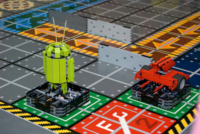 More sweet remote controlled Lego robots compete in a larger than life Robo Rally game.