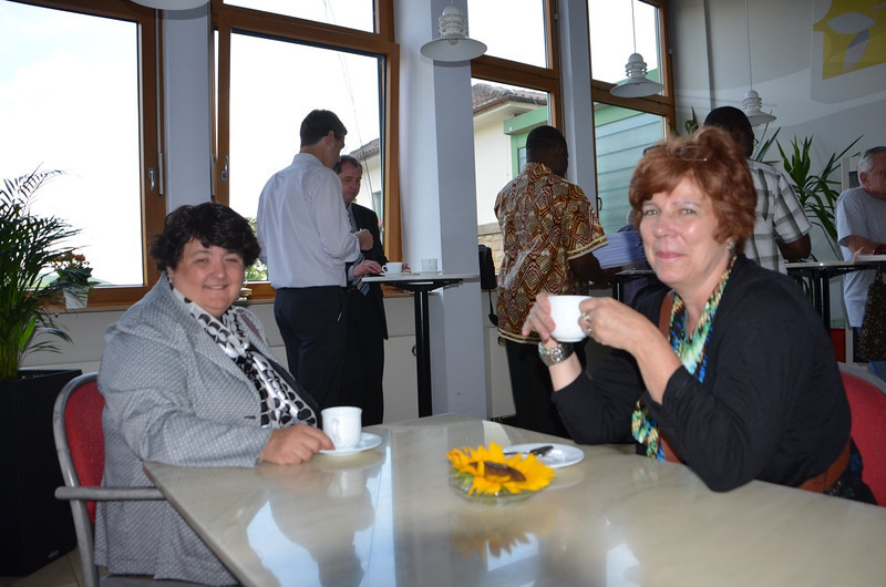 North American principals chat over coffee
