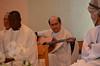 Fr. João Carlos Almeida tunes his guitar before Mass.