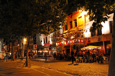 "Night image of the atmosphere at the ""Bij St Jacobs"" square in Ghent (Gent), Belgium during the 2010 Ghent Festivities (Gentse Feesten)."