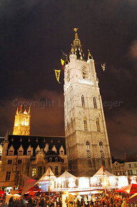 Night image of the Belfry Tower (in front) and the Tower of the Cathedral of St Bavo in Ghent (Gent), Belgium during the 2010 Ghent Festivities (Gentse Feesten).