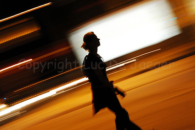 A female roller skater on the road at night during the 2010 Ghent Festivities in Ghent (Gent), Belgium.
