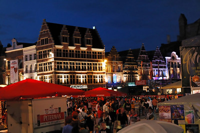 Night photo of the atmosphere on the Korenmarkt in Ghent (Gent), Belgium, during the Ghent Festivities (Gentse Feesten).