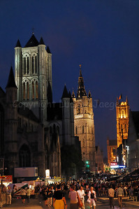 "Night shot of the ""Three Towers"" that mark the city of Ghent (Gent) in Belgium: the Belfry Tower (center), the Tower of the Church of St Nicolas (left) and the Tower of the Cathedral of St Bavo (right)."