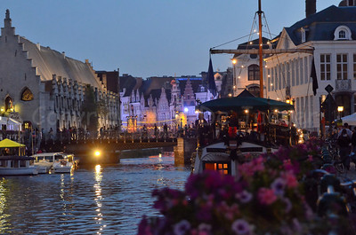 Late evening view on the Vleeshuisbrug, captured from the Kraanlei in Ghent (Gent), Belgium during the 2011 Ghent Festivities (Gentse feesten). On the right is the party boat Gentse Barge.