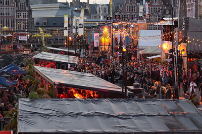 Late afternoon view of the highly colorful Polé Polé Festival during the Ghent Festivities (Gentse Feesten) 2011 in Ghent (Gent), Belgium is one of the many attractions bringing thousands of people to the place between Graslei and Korenlei.