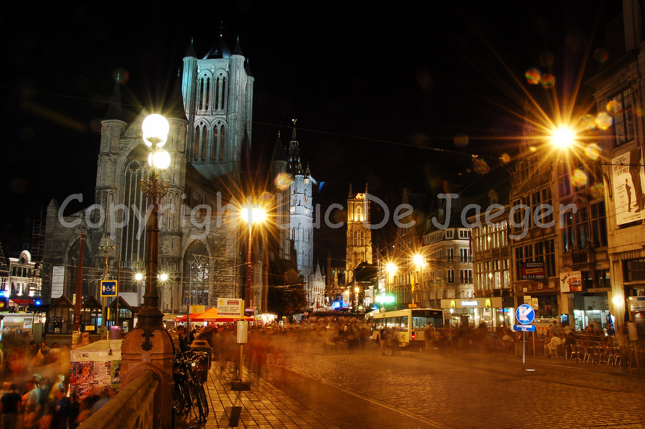 Shot from the St Michielsbrug (St Michael's Bridge) direction center of the city. Plenty of people around! You can see the three towers: (in front)  St Nicolas church (St. Niklaaskerk), (in the middle) the Belfry (Belfort) and in the background the Cathedral of St. Bavo (St Baafskathedraal).