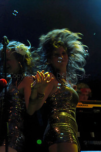 Flamenco Fiona (Fien) and Jazzy Jay (Joke), backing vocals of The Vicious, a highly professional Belgian party cover band that brought a stunning and impressive music performance on the Korenmarkt during the Ghent Festivities (Gentse Feesten) 2007, Belgium.  (Original format disabled to protect from theft!)