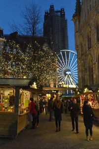 View on the Ferris Wheel on the St Bavo square (Sint Baafsplein) and the Christmas Market at dusk.