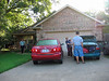 The Albrecht's home in Bryan, Texas. George getting car ready to leave on Tuesday July 25th.