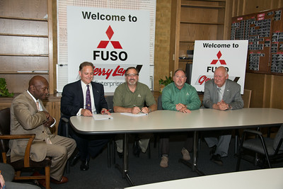"Gerry Lane Enterprises welcomes Mitsubishi FUSO.  Pictured Left to Right are: Cedric Patton, Co-Owner | Eric Lane, President Gerry Lane Enterprises | Tom Hotham,  Mitsubishi FUSO Regional VP | Brad Munchrath, Mitsubishi FUSO District Sales Manager | ""E.P. Hungry"" Exnicious, Executive Manager of Gerry Lane Mitsubishi"