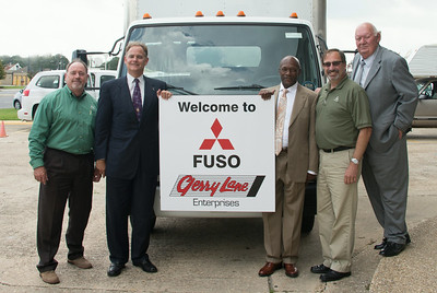 Pictured Left to Right are  Brad Munchrath, Mitsubishi FUSO District Sales Manager | Eric Lane, President Gerry Lane Enterprises | Cedric Patton,  CoOwner | Tom Hotham, Mitsubishi FUSO Regional VP | E.P. Hungry Exnicious, Executive Manager Gerry Lane Mitsubishi