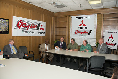 "Gerry Lane Enterprises welcomes Mitsubishi FUSO.  Pictured Left to Right are: Terry Bell | Cedric Patton, Co-Owner | Eric Lane, President Gerry Lane Enterprises | Tom Hotham,  Mitsubishi FUSO Regional VP | Brad Munchrath, Mitsubishi FUSO District Sales Manager | ""E.P. Hungry"" Exnicious, Executive Manager of Gerry Lane Mitsubishi"