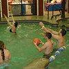 Erin, Cassie, Alex and Cory playing basketball in the pool.  ( 2009 )