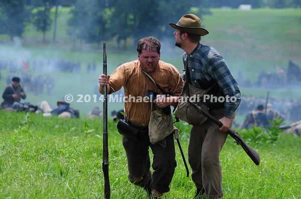 Reenactors play wounded Rebels after Pickett's Charge MIN_9870