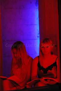 Female students of the Ghent Institute of Arts (Secundair Kunstinstituut) in lingerie whisper lovely and sensual words from the inside of a building to the passers-by during the 2012 Light Festival in Ghent (Gent), Belgium.