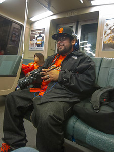 Giants Fan on BART with camera