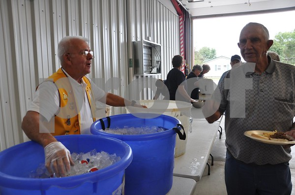 Lion's Club President Jim LaVelle serves sodas at the Lions Club lunch.