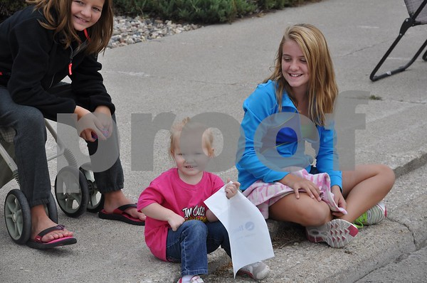 From left, Katelyn and Riley Phillips, and Rachel Fishel, of Humboldt. Riley entered the Cutie Contest Friday night.