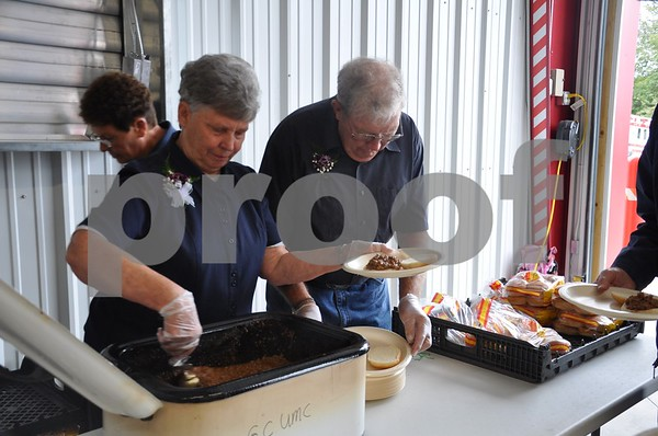 Parade Grand Marshals Karen and Don Day serve sandwiches at the Lions Club lunch.