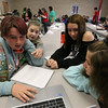 Girl Scouts Cyber Challenge at UMass Lowell Kitson Hall, for girls to use their coding and hacking skills. From left, 7th grader Aidyn Harris of Rindge, N.H., and 8th graders Harmony Briggs of Lowell, and Marissa Abshire and Jessica Allard of Dracut. (SUN/Julia Malakie)