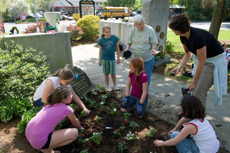 Daisy instructing the girls of Troup 72502 on the finer points of flower planting