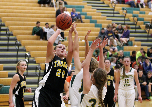 Record-Eagle/Keith King<br /> Traverse City Central's Lauren Lozowski (20) shoots the ball against Traverse City West Friday, January 18, 2013 at Traverse City West High School.
