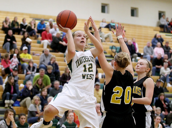 Record-Eagle/Keith King<br /> Traverse City West's Kiley Kreple (12) shoots the ball against Traverse City Central Friday, January 18, 2013 at Traverse City West High School.