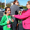 Debbie Blank | The Herald-Tribune<br /> Batesville Intermediate School third-grader Grace Walter gets her medal from coach Carla Radenheimer.