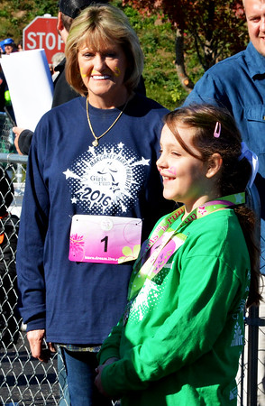 Debbie Blank | The Herald-Tribune<br /> South Ripley Elementary School third-grader Jade Hanna, 8, celebrates that feeling of accomplishment with her running buddy, grandmother Sherry Green, Ogleville.