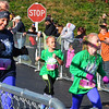 Debbie Blank | The Herald-Tribune<br /> Jac-Cen-Del Elementary School fourth-grader Sophia Sullivan (right), 10, Osgood, crosses the finish line next to running buddy Mollie Fry (left).