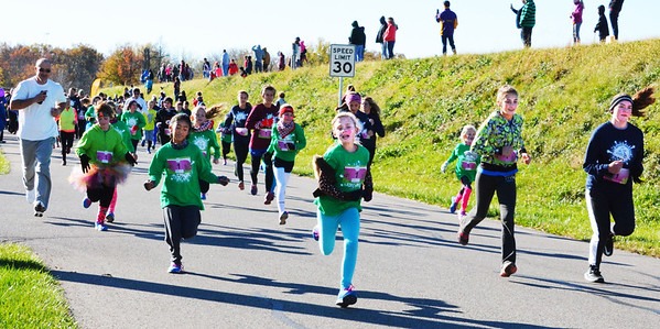 Debbie Blank | The Herald-Tribune<br /> Family members and friends stood near the Liberty Park Reservoir to get a good view of the 5K's start at 10 a.m. The weather was crisp and sunny.