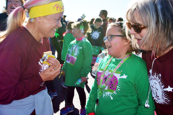 Debbie Blank | The Herald-Tribune<br /> Brookville Elementary School student Kylea Stamper (center), 9, chats with coach Jenny Wilz (right) and another volunteer after the event.