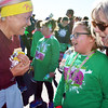 Debbie Blank   The Herald-Tribune<br /> Brookville Elementary School student Kylea Stamper (center), 9, chats with coach Jenny Wilz (right) and another volunteer after the event.
