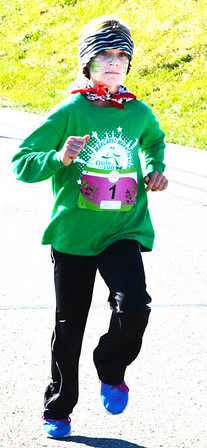 Debbie Blank | The Herald-Tribune<br /> Kate Hamilton, 10, Westport, was the first of 233 third- through fifth-graders to cross the finish line at the Margaret Mary Health Girls on the Run 5K in Batesville Nov. 12. She is a South Decatur Elementary School fifth-grader.