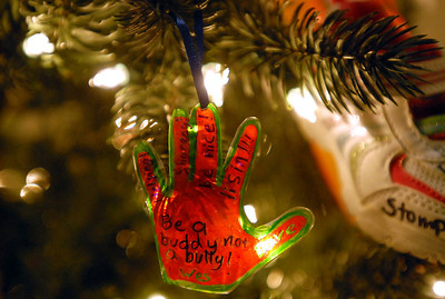 An anti-bullying message is on one of the many Christmas trees on display at the Gevena History Center created by a child from the Geneva Park District as part of the Giving Tree program Wednesday Dec. 19, 2012. The trees are judged by votes from residents. Erica Benson-ebenson@shawmedia.com