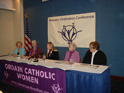 """WOC press conference launching """"Giving the Gift of Women's Leadership"""" campaign, with mobile billboard, inclusive Catholic Mass presided by women, and public vigil calling for the pope to open the doors to women's ordination.  From left to right: Bridget Mary Meehan, Gerry Ruach (WOC Board President), Aisha Taylor (WOC executive director), Elsie McGrath, and Rose Marie Hudson."""