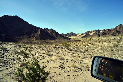 strong contrast between harsh lava peaks and soft sand
