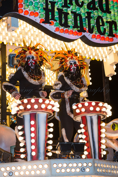 "Two cannibals on the Globe Carnival Club float ""Head Hinters"" at the 2013 Glastonbury Carnival"