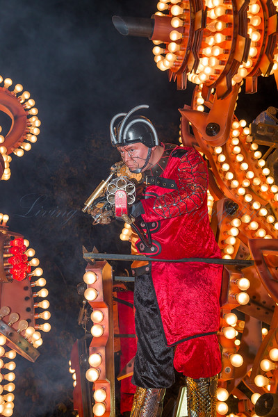 "A space warrior stands ready to shoot on the Ramblers Carnival Club float ""Swarm Force"" at the 2013 Glastonbury Carnival"