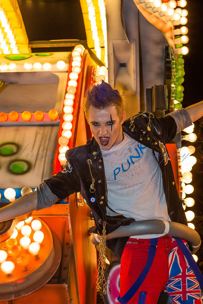 """A Punk postures on the Marketeers Carnival Club float """"Anarchy"""" at the 2013 Glastonbury Carnival"""