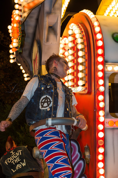 "A Punk postures on the Marketeers Carnival Club float ""Anarchy"" at the 2013 Glastonbury Carnival"