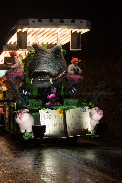 "Glastonbury, UK, 18th November 2017, Nunsford Nutters Carnival Club float ""Three Little Pigs"" at the 2017 Glastonbury Carnival"