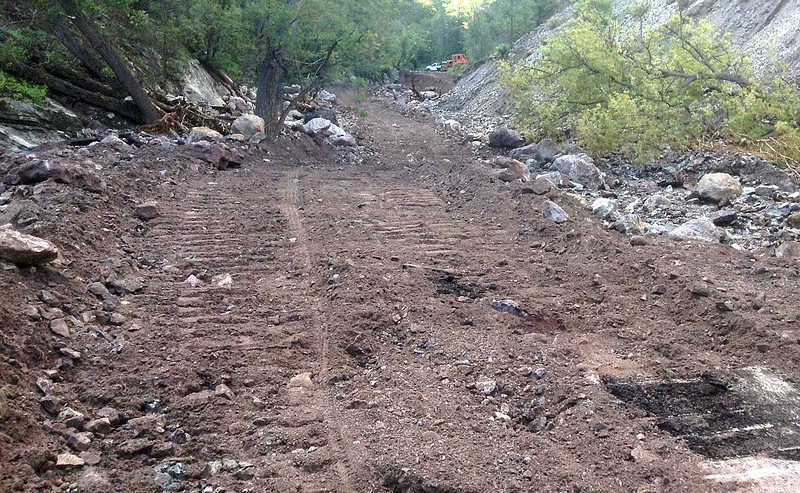 Building some road for access to Mogollon. The flood was Saturday night & Sunday. This photo is from Wednesday morning. Food, clean water, and people will soon be able to move to & from town.
