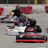Drivers take different lines through the corner during action at the Mayor's Cup Grand Prix on Saturday.