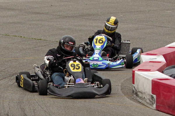 Drivers slide their carts through the turn and onto  the front straight at the Mayor's Cup Grand Prix at the Mounds Mall.